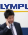 Grilled About Deadly Superbug Outbreaks, Execs At Scope Maker Olympus Take Fifth